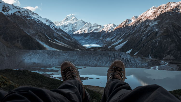 A person taking in the view of the mountains in New Zealand