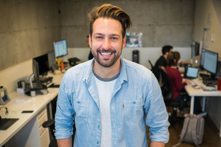 Man smiling in office work environment